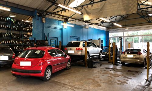 HiQ Rushden cars in workshop