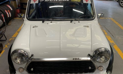 A beautiful white classic mini with Dunlop windscreen sticker here for servicing at HiQ Tyres & Autocare Maidstone.