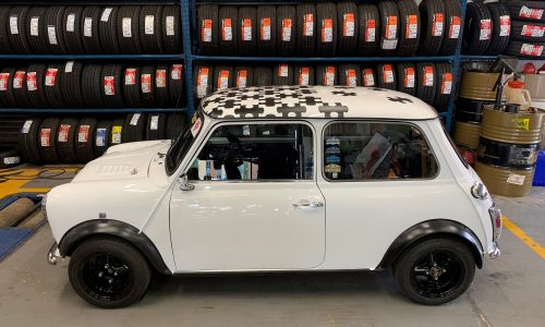 A side profile for a beautiful white classic mini here for a service at HiQ Tyres & Autocare Maidstone