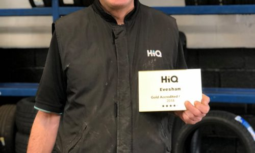 HiQ Evesham manager Kevin receiving their Gold Standard Award 2018