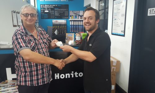 HiQ Honiton - Julian handing over Love2Shop vouchers