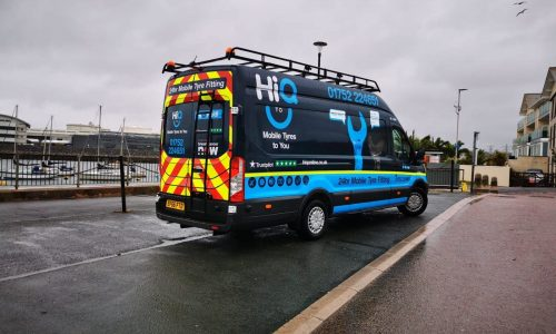 Picture of the back and side of the HiQ Plymouth Van
