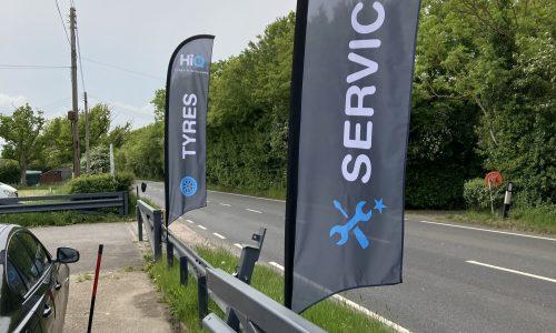 HiQ-Tyres-Autocare-Ashford-exterior-flags.jpg