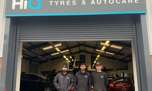 Hi Q Tyres Autocare Walsall team photo under the shutter door