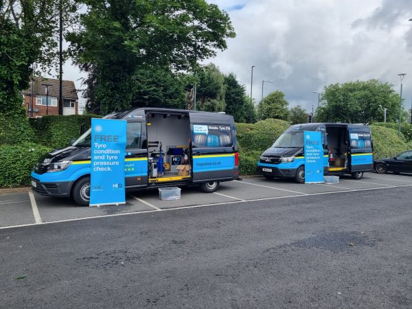 Hi Q Tyres Autocare Coventry Mobile vans with roll sheet marketing